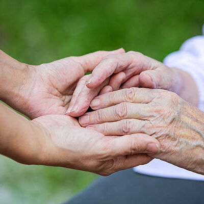 hands-of-young-adult-and-senior-women-PGU37PJ copy